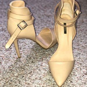 Nude pointed heels.